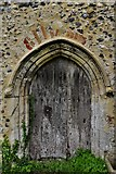 TG1508 : Bawburgh, St. Mary and St. Walstans' Church: Disused north doorway by Michael Garlick