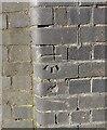 SP0981 : OS benchmark - Hall Green, railway bridge on Robin Hood Lane by Richard Law