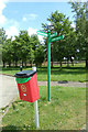 TL9990 : Signpost at Hall Farm Horse Rescue Centre by Adrian Cable