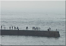 SW3526 : Figures on the breakwater at Sennen Cove by Rod Allday