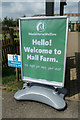 TL9990 : Welcome to Hall Farm sign by Adrian Cable