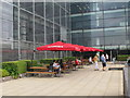 TQ3280 : Picnic tables and umbrellas, Nomura roof garden by David Hawgood