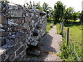 C5247 : Stone wall beside Clonca Church by Kenneth  Allen