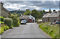 NY5218 : Eastern entry into Bampton Grange by Nigel Brown
