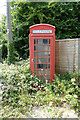 TM4069 : Disused Telephone Box  near Darsham Station Emporium by Adrian Cable