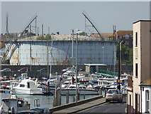 SY6778 : Dead gas holder - Weymouth by Chris Allen