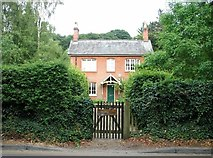 TG2407 : Chestnut Cottage in Whitlingham Lane by Evelyn Simak
