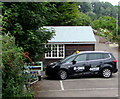 SY3391 : M-Cabs taxi and office, Lyme Regis by Jaggery