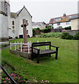 SY3392 : Wooden bench in a Lyme Regis churchyard by Jaggery