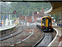 SX9193 : A train for Waterloo pulls into Exeter St David's Station by John Lucas