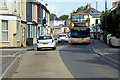 SX9066 : Open Topped Bus in Hele Village by David Dixon