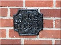 TG2309 : Doughty's Hospital - parish boundary marker by Evelyn Simak