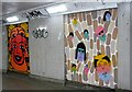 TG2208 : St Stephens underpass - heads by Evelyn Simak