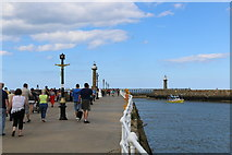 NZ8911 : Walking on the West Pier at Whitby by Andrew Diack
