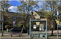 SK2276 : Eyam: The Bullring bus stop by Michael Garlick