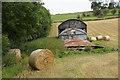 SO3289 : Barn and bales near Bishop's Castle by Bill Boaden