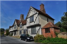 TL9836 : Stoke by Nayland: A terrace of half timbered dwellings next to the church by Michael Garlick