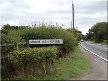 TL9326 : Eight Ash Green Village sign by Adrian Cable