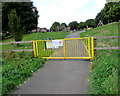ST5871 : Yellow gates at the entrance to South Street Park, Bedminster, Bristol by Jaggery
