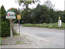 TL8928 : The Street & Wakes Colne Village sign by Adrian Cable