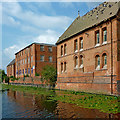 SK5704 : Canalside buildings at Friars Mill in Leicester by Roger  Kidd
