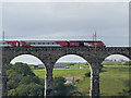 NT9953 : LNER train crossing the Royal Border Bridge (detail) by Stephen Craven