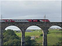NT9953 : LNER train crossing the Royal Border Bridge (detail) by Stephen Craven