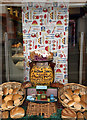 NH5458 : A window display at William Deas, Baker, Dingwall by Walter Baxter