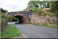 SK6132 : Railway Bridge #27 across Station Road by Roger Templeman
