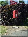 NZ1928 : Elizabeth II postbox on Woodhouse Lane, Bishop Auckland by JThomas