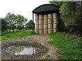 SO8425 : Straw bales in a Dutch barn by Philip Halling