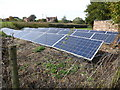 SJ4304 : Solar panels in the garden by Jeremy Bolwell