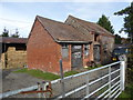 SJ4304 : Buildings on a smallholding south of Longden Common by Jeremy Bolwell
