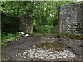 NS4573 : Cobbled entrance to old stables by Lairich Rig
