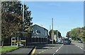 SJ3776 : Chester Road approaching Tesco Express store by John Firth