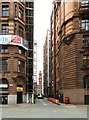 SJ8497 : Alleyway between Manchester House and Asia House by Gerald England