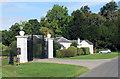 SU5332 : Avington Park, gate and lodge by Des Blenkinsopp