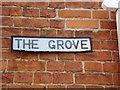 TL8528 : The Grove sign by Geographer