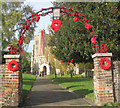 SP9211 : The main gateway to Tring Church - with poppies for Armistice Day by Chris Reynolds
