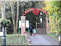 SP9211 : Poppies decorate the gate to the Tring Memorial Garden by Chris Reynolds