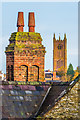 SO5174 : Chimney and tower by Ian Capper
