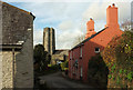 SX7744 : Cottages and church, Sherford by Derek Harper