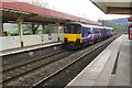 SE0623 : Passenger train departs Sowerby Bridge Station for Manchester by Roger Templeman