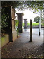 SJ3287 : Gateposts and a bench mark in Mersey Park, Tranmere by John S Turner