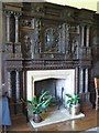 SO0897 : Carved panels around the fireplace in the Blayney room at Gregynog by Penny Mayes