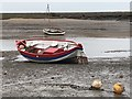 TF8444 : Boats on the mud at Burnham Overy Staithe in Norfolk by Richard Humphrey