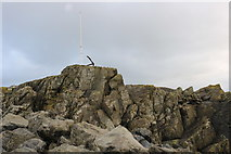 NW9954 : Flag Pole and Anchor on the Dorn Rock, Portpatrick by Billy McCrorie