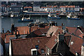NZ9011 : Whitby rooftops and harbour by Ian Taylor