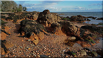 NH7358 : Red rocks, sands and gravels at Rosemarkie by Julian Paren