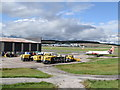 NJ8812 : Snow clearing machines, Aberdeen Airport by Bill Harrison